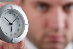 Businessman showing clock to you Royalty Free Stock Images