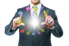 Businessman showing colorful icons on air. Cropped imgae of businessman showing media icons Stock Photo