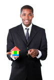 Businessman showing a construction of a new house Stock Photos