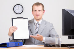 Businessman showing a contract in his office Stock Images