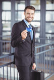 Businessman showing credit card while standing in office Royalty Free Stock Image