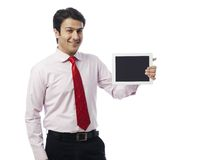 Businessman showing digital tablet Royalty Free Stock Photo