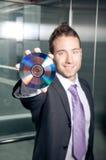Businessman showing disk Stock Images