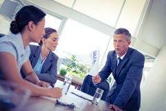 Businessman showing documents during meeting Stock Photos