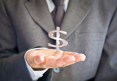 Businessman showing dollar sign. On hand Stock Photography