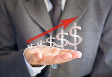 Businessman showing dollars sign graph Royalty Free Stock Photos