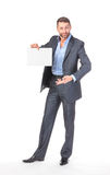 Businessman showing an empty board to write Royalty Free Stock Images