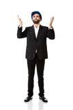 Businessman showing empty copyspace in hands. Royalty Free Stock Photo