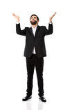 Businessman showing empty copyspace in hands. Royalty Free Stock Images