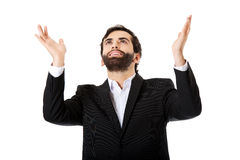 Businessman showing empty copyspace in hands. Royalty Free Stock Image