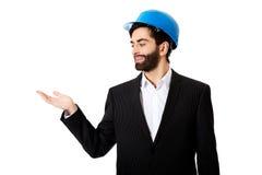Businessman showing empty copyspace on palm. Stock Photos