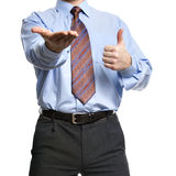 Businessman showing empty hand and thumb up Royalty Free Stock Photo