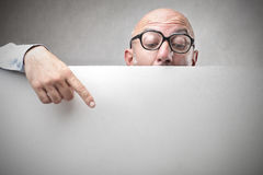 Businessman showing an empty paper Royalty Free Stock Image