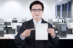 Businessman showing empty placard Royalty Free Stock Photo