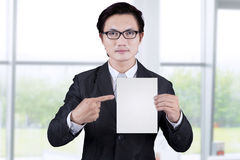 Businessman showing empty placard 1 Stock Photos