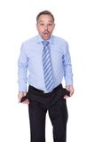 Businessman Showing Empty Pockets Royalty Free Stock Photo