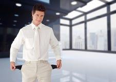 Businessman showing empty pockets. Digital composite of Businessman showing empty pockets Stock Photos