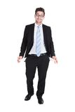 Businessman showing empty pockets. Full length of young businessman showing empty pockets over white background Royalty Free Stock Image