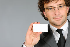 Businessman showing emty business card. Portrait of businessman showing empty business card Royalty Free Stock Photos