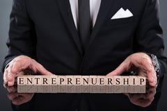 Businessman showing entrepreneurship blocks Royalty Free Stock Photos