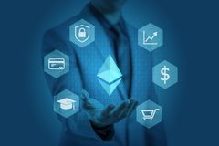 Businessman is showing ethereum graphic on hands Royalty Free Stock Photography