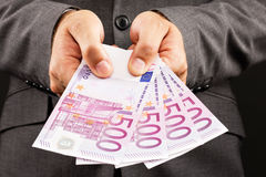 Businessman showing euro banknotes Stock Image