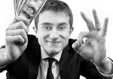 Businessman showing fan of money and sign OK Royalty Free Stock Photo