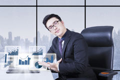 Businessman showing financial chart on screen Stock Images