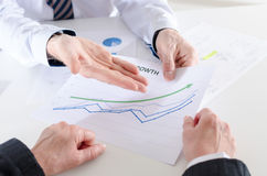 Businessman showing a financial graph Royalty Free Stock Images