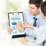 Businessman showing financial report royalty free stock image