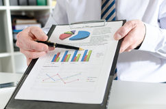 Businessman showing financial results Royalty Free Stock Photo