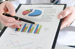Businessman showing financial results Stock Photos