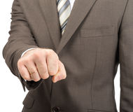 Businessman showing fist. Isolated on white background Stock Image