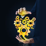 Businessman showing gears cogs to success concept Stock Photos