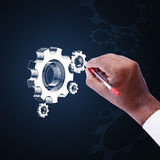 Businessman showing gears cogs to success concept Stock Image