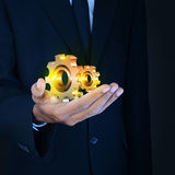 Businessman showing gears cogs to success concept Royalty Free Stock Images