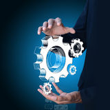 Businessman showing gears cogs to success concept vector illustration