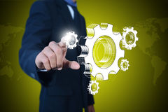 Businessman showing gears cogs to success concept Royalty Free Stock Photography