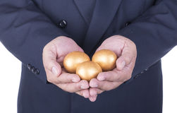 Businessman showing golden egg. concept business Stock Photos