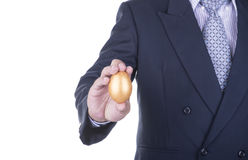 Businessman showing golden egg. concept business Royalty Free Stock Image