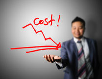Businessman showing graph of cost reduction Stock Images