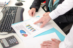 Businessman showing a graph with his index finger Royalty Free Stock Images