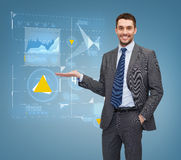 Businessman showing graph on virtual screen Stock Images