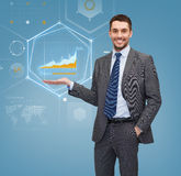 Businessman showing graph on virtual screen Stock Photo