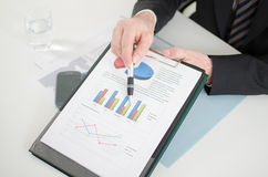 Businessman showing graphs Stock Image