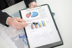 Businessman showing graphs Stock Photos