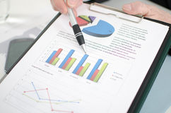 Businessman showing graphs Royalty Free Stock Photo
