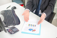 Businessman showing graphs Stock Images
