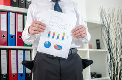 Businessman showing graphs with poor results Stock Photography