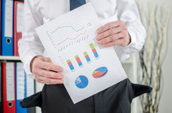 Businessman showing graphs with poor results Stock Images